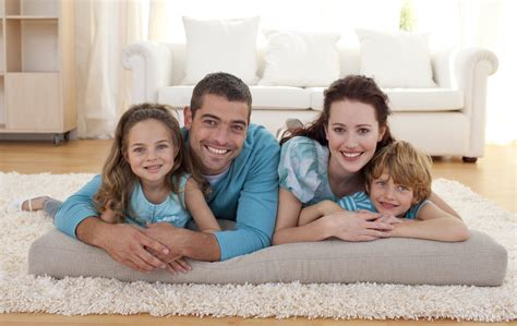 family in living room family on floor in living room spifco specialty cleaning