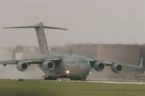 watch huge military plane lands on tiny runway at wrong