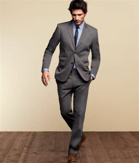 gray suit powder blue shirt navy tie finished with