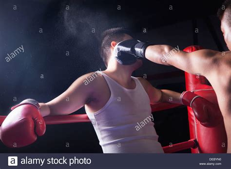 how to throw a knockout over the shoulder view of male boxer throwing a knockout