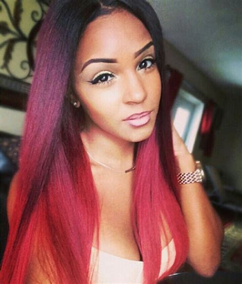 Best Hair Color For Hispanic Women | purple red and orange hair color on black or hispanic