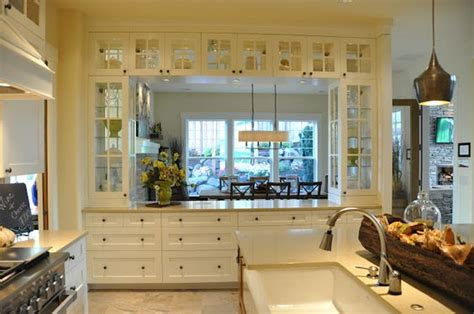 love kind pass kitchen dining room lots glass cabinets storing dishes serving pieces home