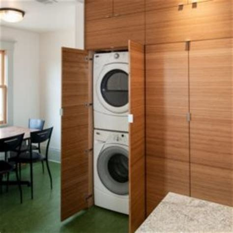 concealed washer and dryer concrete casa gold with stacked volumes home decorating
