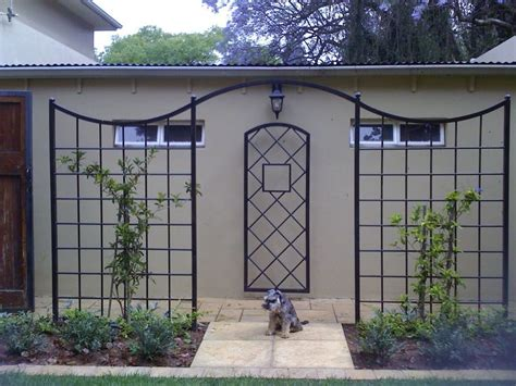 ironwork trellis 17 best ideas about wrought iron fences on