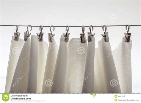 hangers for curtains cream colored curtain hanging on a string on metal hooks