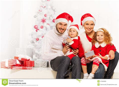 Happy Young Family Opening Presents On Christmas Stock ... Happy Kids Opening Christmas Presents