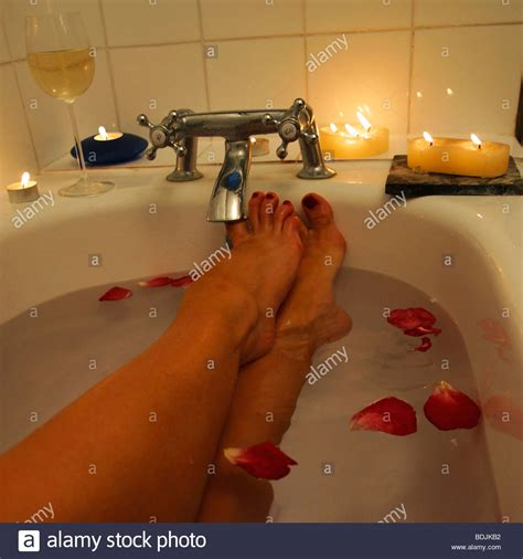 sexy legs in bathtub ladies legs only in bath with petals floating in water
