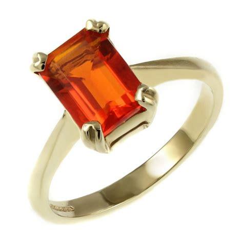 9ct yellow gold 7x5mm emerald cut opal ring