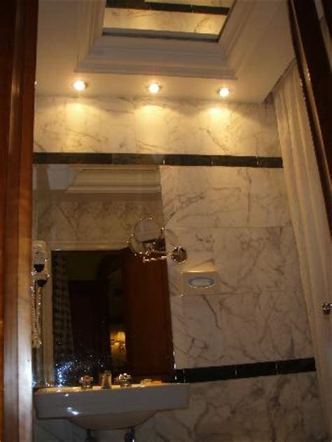 marble tiled bathroom with mirror ceiling picture of