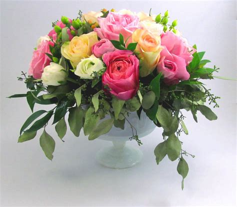 diy beautiful flying flower arrangements make a rununculus and garden rose centerpiece