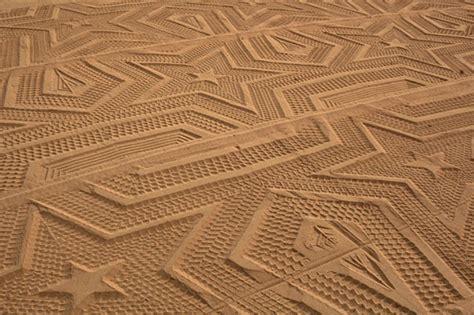 sand pattern artist tractor creates amazing sand art on the beach bored panda