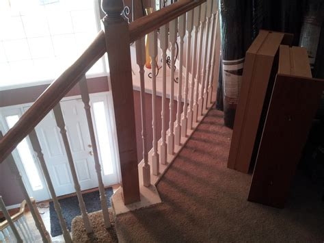 how to install laminate flooring around stair railings