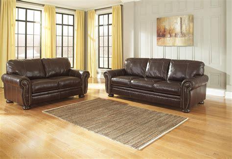 ashley furniture leather nailhead sofa ashley signature design banner 5040438 traditional leather