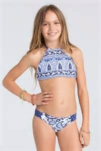 Corona beach girls sun oil blue towels white sand cancer girls