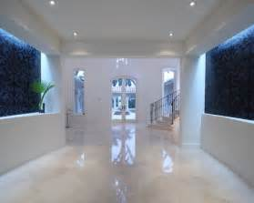 Home Decor Flooring large trendy foyer photo in other with marble floors