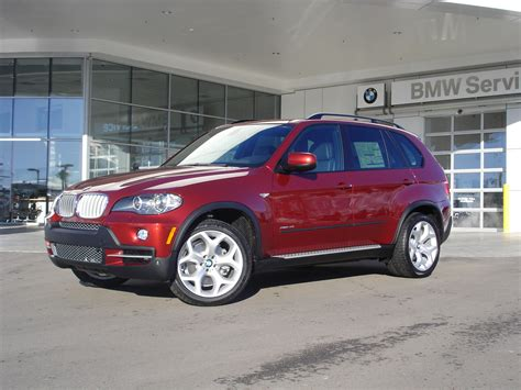 red bmw x5 bmw x5 in vermillion red color an x6 color