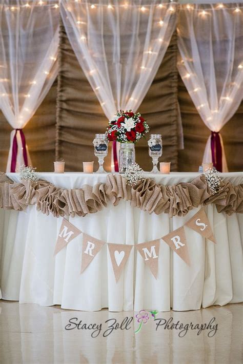 diy wedding backdrop with lights reception decorations red roses burlap lights