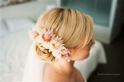 Wedding Hair Side Bun With Flower by 17 Best Images About Island Wedding Hairstyles On