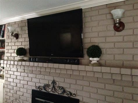 mount tv on brick fireplace hide wires yes you can mount your tv to your brick fireplace without the wires showing the wires are