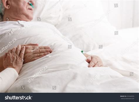 man laying in bed sick senior man laying hospital bed stock photo 674344555
