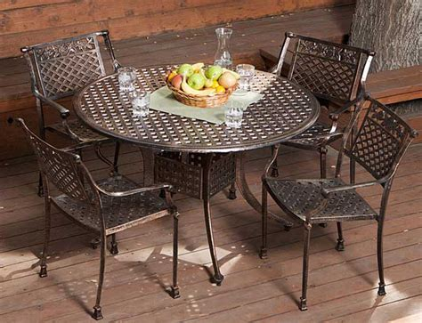 Metal Patio Table And Chairs Set by Sebastian Cast Aluminum Outdoor Dining Set In Copper