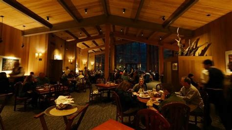mountain room restaurant overall of the mountain room with three vaulted ceilings and warm lighting throughout picture