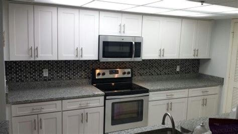Small U Shaped Kitchen With Island beach front condo shaker style cabinets azul platino