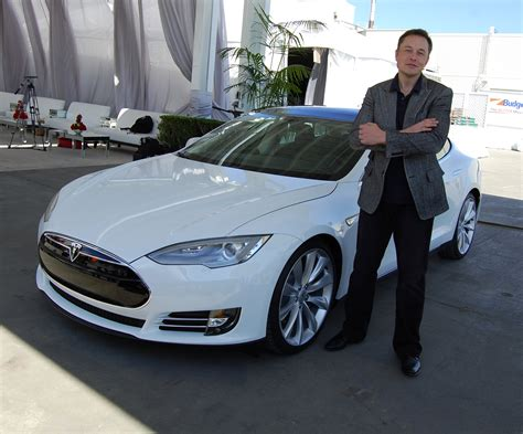 tesla unveils autopilot system but don t let go of the