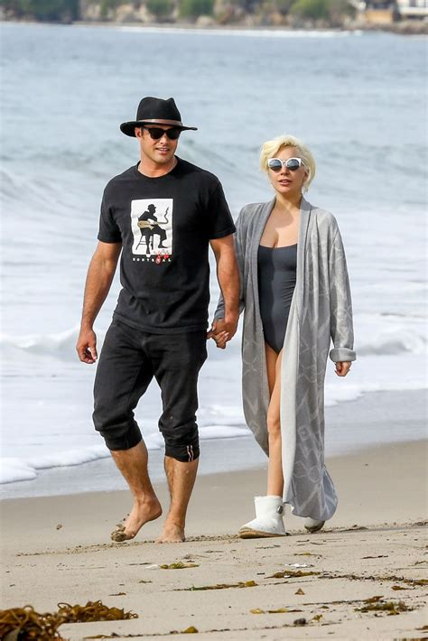 what is your celebrity boyfriend taylor kinney and lady gaga walk on the beach picture