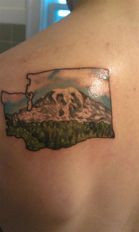 montana tattoo freshly done washington state with mt rainier by alfredo