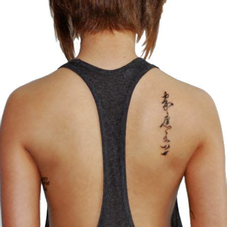 vertical back tattoo collection of 25 on right back shoulder