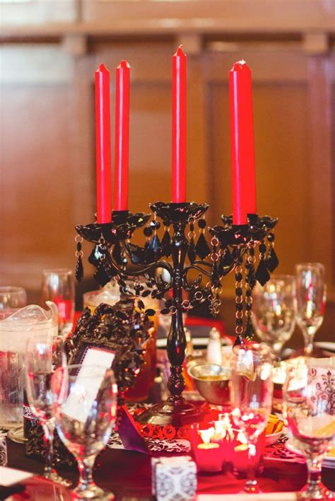 black candelabra centerpiece with red candles gothic
