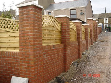 garden wall with brick pillars and decorative wooden
