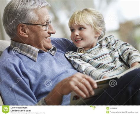Grandfather S | girl with grandfather reading story book stock images