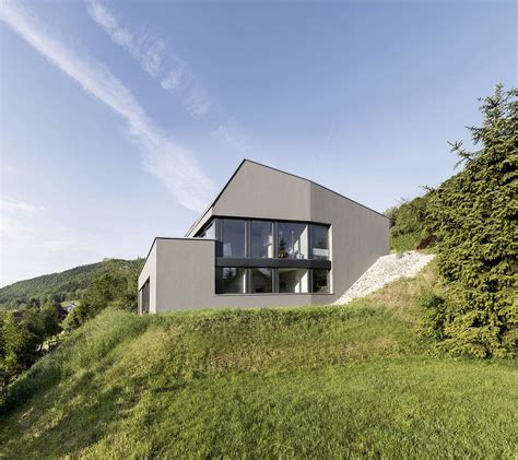 houses built on slopes swiss delight modern single family house in concrete and wood