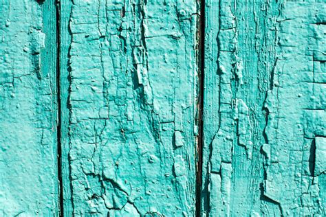 old wooden background with peeled colour and cracks mint