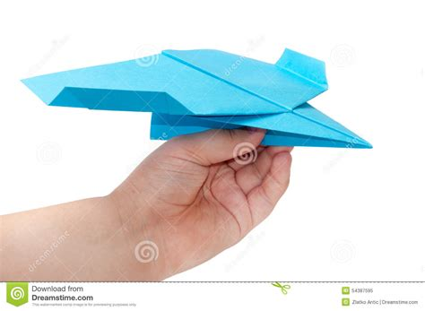 Origami Holding - kid holding paper origami airplane stock photo image