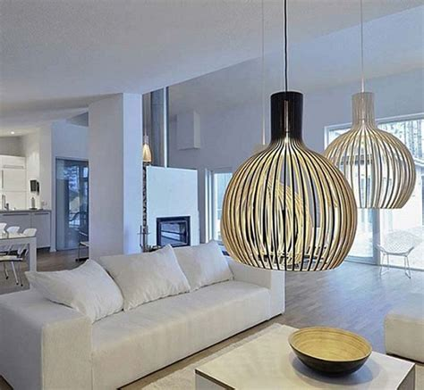 Cage Shaped Modern Pendant Lighting Fixtures Over A White Living Room Pendant Lights