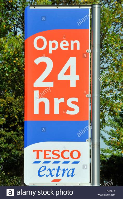 tesco opening tesco supermarket store open 24 hours sign stock