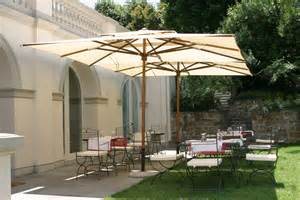 spacious outdoor living space with two rectangle umbrellas