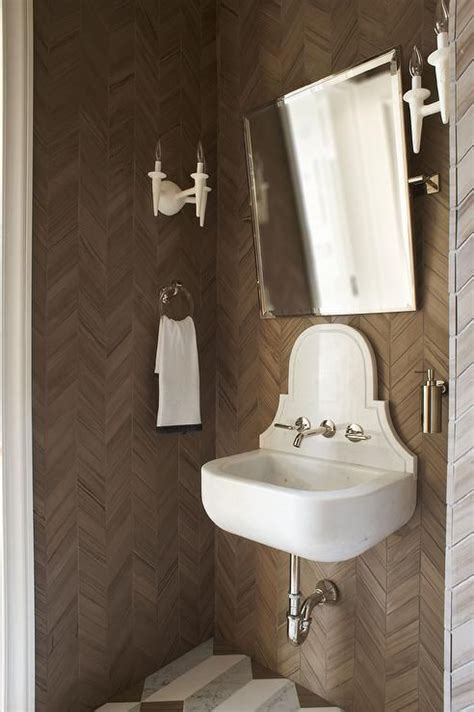 wall mounted marble sink white and brown powder room boasts walls clad in brown