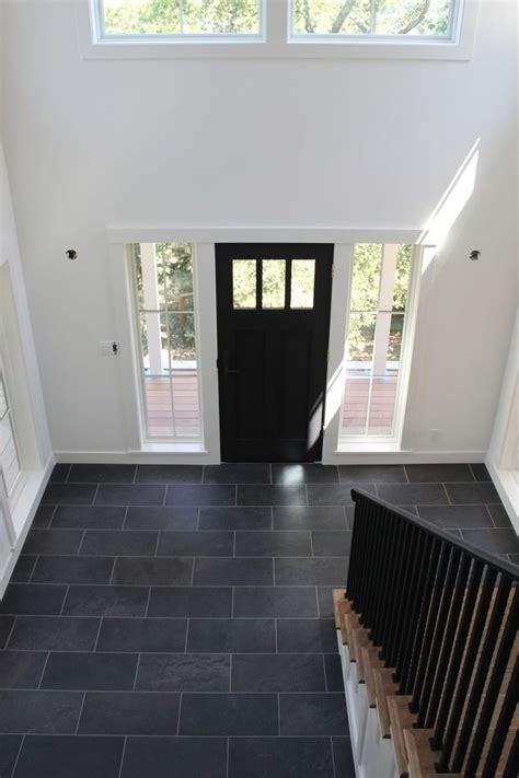 White Walls Black Door And Tile Floor All That S Front Door Tiles