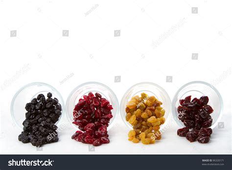 Fruits Kismis Apricot Cranberry Blueberry Raisin Murah dried fruit in four varieties raisins cranberries cherries and blueberries on a white