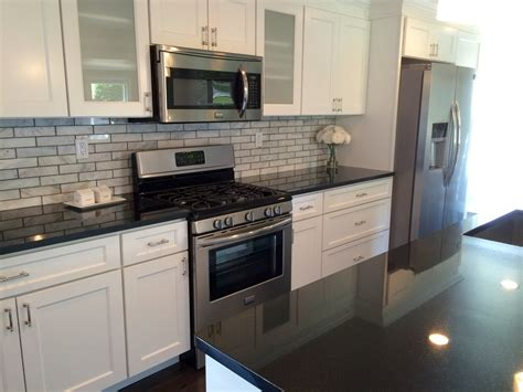 Dark Granite Countertops White Cabinets Home Ideas White Kitchen Cabinets Black Granite
