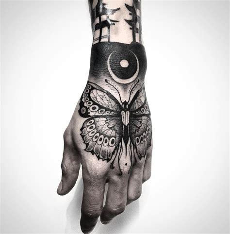 black butterfly on guys hand best tattoo design ideas