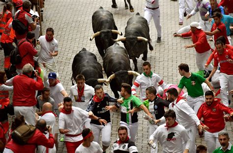 Running With The Bulls spain s running of the bulls 13 injured on day
