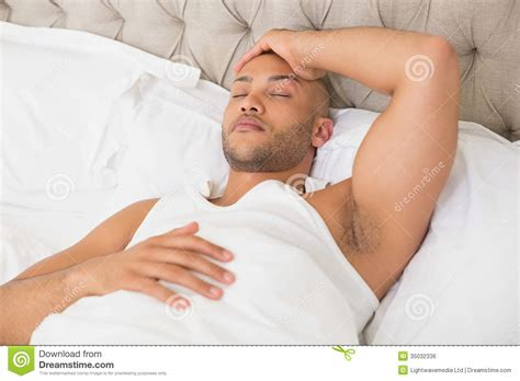 bed man young man sleeping in bed royalty free stock image image