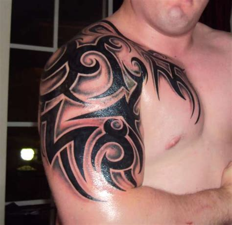 tribal chest arm tattoo awesome tribal chest and sleeve fresh ideas