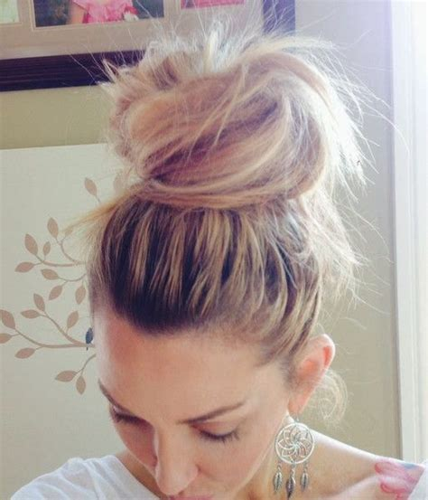 is putting hair in a bun a new fad how to beauty how to make a messy top knot bun top knot