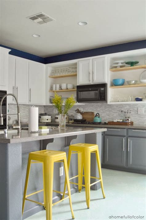 gray and yellow kitchen love the white top and grey bottom cabinets i like the